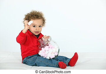Little boy with bowl of marshmallows