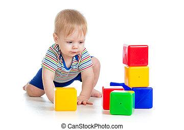 little boy with building blocks
