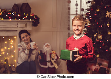 little boy with christmas present