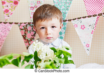 little boy with colorful flags on the background