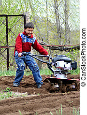 little boy with cultivator