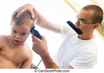 Little Boy With Downs Syndrome Getting His Haircut