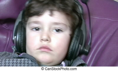 Little boy with earphones - Listen to the Music