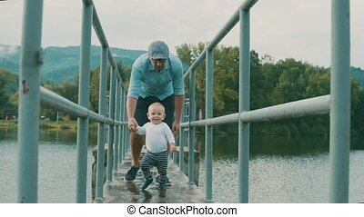 Little boy with father making first steps in nature. -...