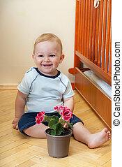 Little boy with flower