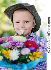 Little boy with flowers for Mum