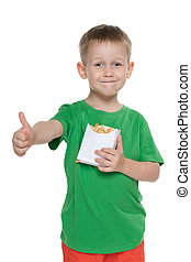 Little boy with fries holds his thumbs up