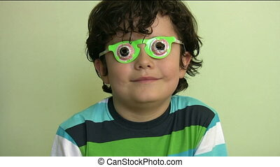 Little boy with funny glasses