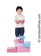 Little boy with gifts on white background