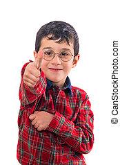 little boy with glasses shows big finger up