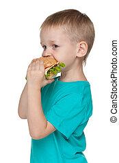 Little boy with hamburger