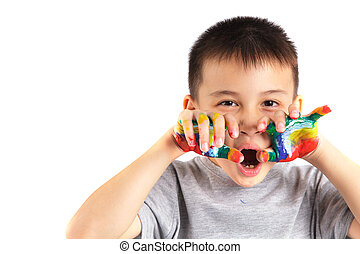 Little boy with hands painted in colorful paint