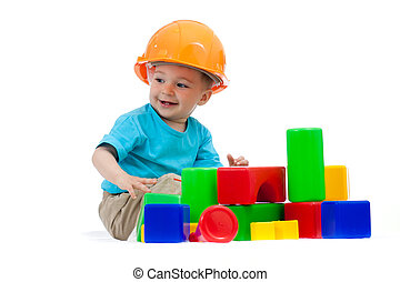 little boy with hard hat and building blocks