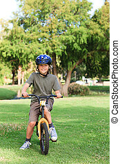 Little boy with his bike