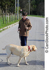 little boy with his dog on a leash on the way