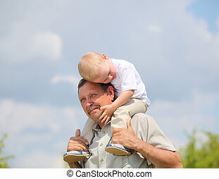 little boy with his grandfather - little boy sitting on the ...