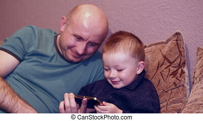 Little boy with his uncle watching
