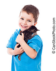 Little boy with kitty in hands