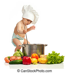 Little boy in chef's hat with ladle, casserole, and vegetables on white background