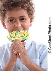 little boy with lollipop