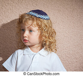 Little boy with long blond curls and blue eyes. Adorable...