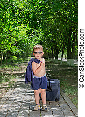 Little boy with luggage