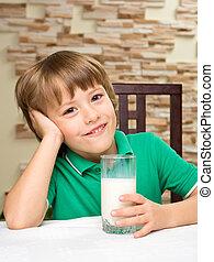 Little boy with milk