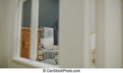 Little boy with mom in her living room house paint on the...