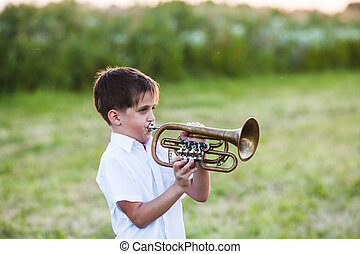 Little boy with musical instrument