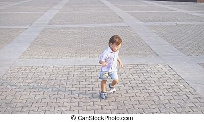 Little boy with nipple running