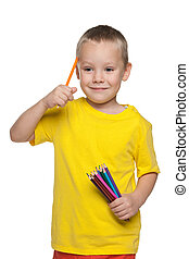 Little boy with pencils