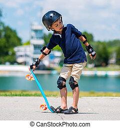 Little boy with penny board