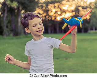Little boy with plane