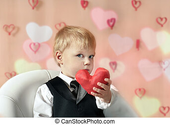 Little boy with red Heart in hands
