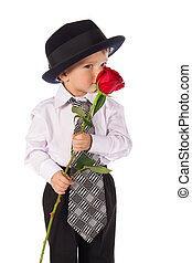 Little boy with red rose