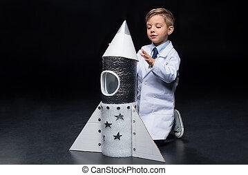 Little boy with rocket
