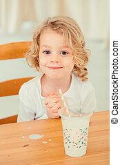 Little boy with spilled milk