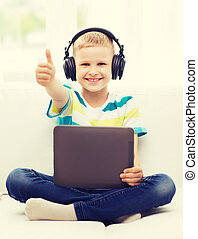 little boy with tablet pc and headphones at home - home, ...