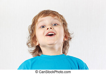 Little boy with the emotion of surprise on a white background