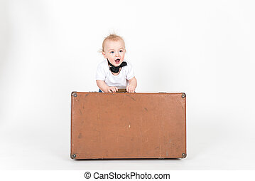 Little? boy with the suitcase on the white background