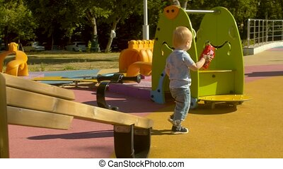 Little boy with the toy on the playground