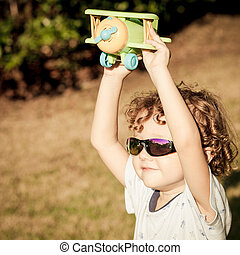 little boy with toy airplane in hands