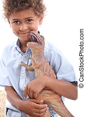 Little boy with toy dinosaur