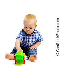 little boy with toys on a white background