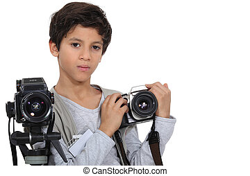 Little boy with two cameras