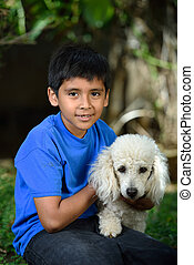 boy with white poodle