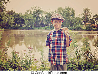 Little Boy with Wooden Fishing Pole by Pond
