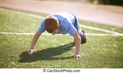 little boy wrung out at the stadium a healthy lifestyle....