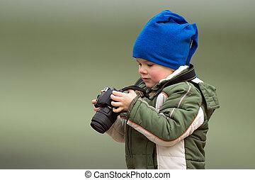 little boy young photographer