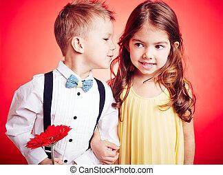 Little boyfriend - Cute little boy whispering something to...